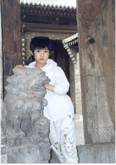 盼母歸:曾錚的女兒攝於2001年