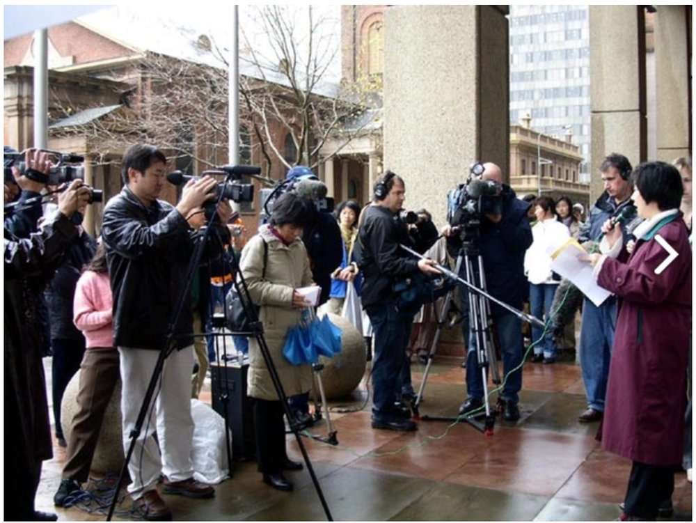 Jennifer speaks at the rally on behalf of Global Coalition to Bring Jiang to Justice (GCBJJ)