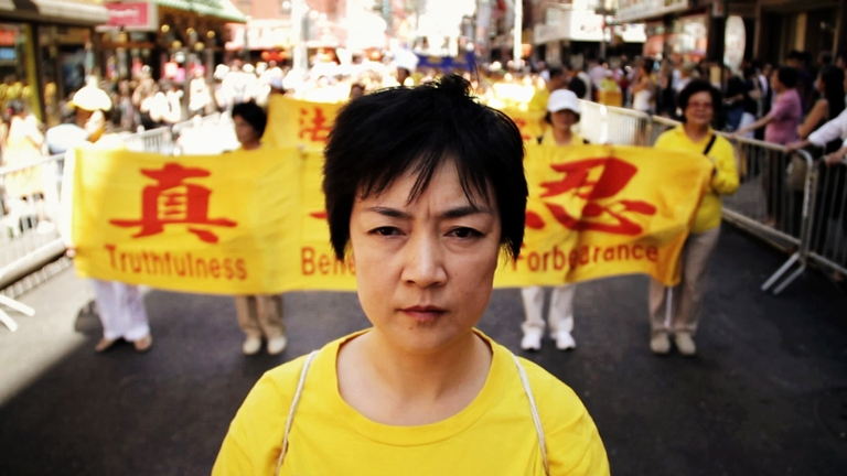 "A movie still of ""Free China: The Courage to Believe"" showing Jennifer Zeng at a human rights parade in New York . (NTD Television)."