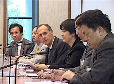 Jennifer addressing a forum inside the Australian Parliament House on March 17, 2005. On the right to her is Bob Brown, former Senator and parliamentary leader of the Australian Greens