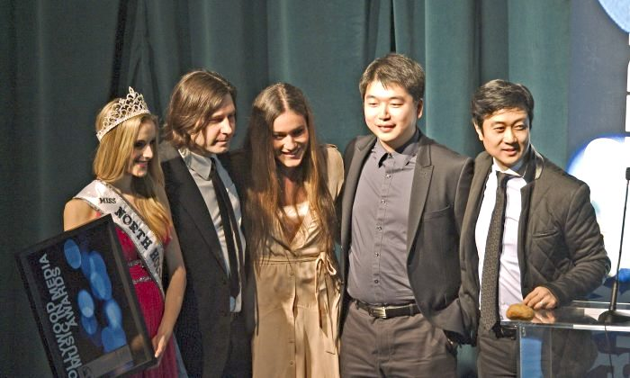 "The ""Free China"" team accepts the HMMA theme song award for ""The Courage to Believe."" (L-R) Miss North Hollywood Teen Mckenzie Seagren holding award, Kevin Dippold, Q'orianka Kilcher, Tony Chen, and Kean Wong. (Robin Kemker/Epoch Times)"