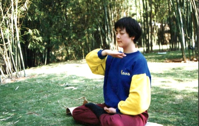 Jennifer Zeng practicing the Falun Gong meditation in 1998 in a park in Shenzhen City, China. (courtesy Jennifer Zeng)