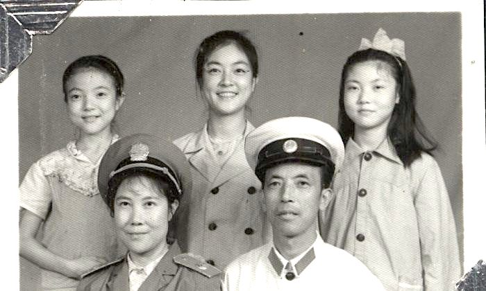 Jennifer's mother was finally allowed to join her father after Jennifer had gone to Beijing for university. This family photo was taken during Jennifer's school vacation when she traveled back to Mianyang. The uniform worn by Jennifer's father was actually for police officers, though he was a lawyer. At that time the legal system in China was still in the initial process of re-establishment, and lawyers were wearing police officer's uniforms. (Provided by Jennifer Zeng)