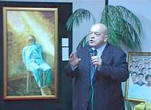 澳洲語言學專家、人權問題顧問麥克·達比在畫展上發言