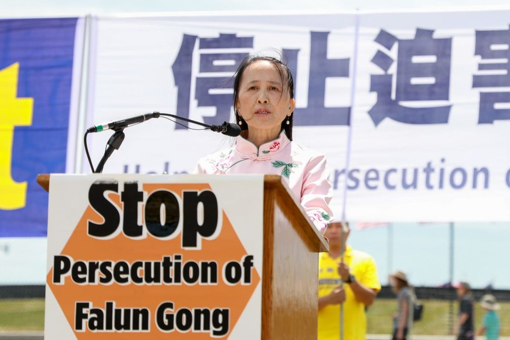 Yi Rong, president of the Global Tuidang Center speaks at the 19th anniversary of the beginning of the persecution of Falun Gong on July 20,1999, at the Washington Monument in Washington on July 19, 2018. (Samira Bouaou/The Epoch Times)