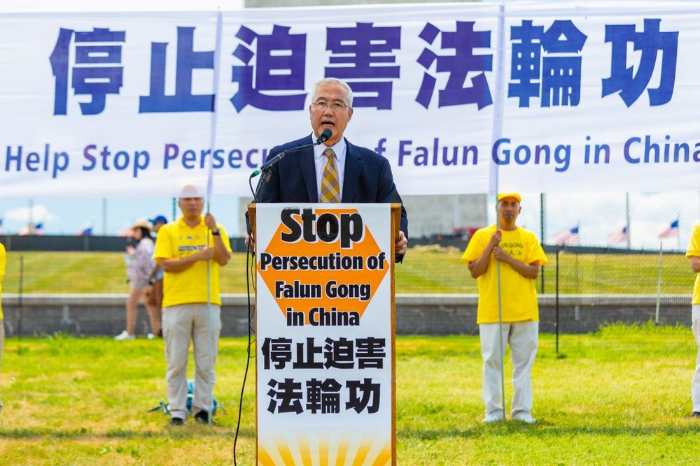 Wang Zhiyuan, chairman of World Organization to Investigate the Persecution of Falun Gong, speaks at a rally calling for an end to the persecution of Falun Gong, in Washington on July 19, 2018 (Mark Zou/Epoch Times)