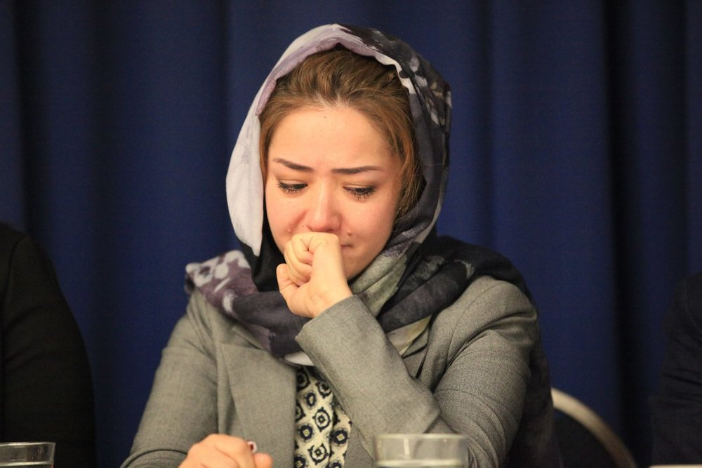 Mihrigul Tursun weeps as she relates her experiences in the detainment camps in Xinjiang, China, at the National Press Club in Washington on Nov. 26, 2018. (Jennifer Zeng/The Epoch Times)