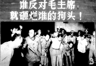 "A photo of "" Anti-rightist Campaign "". The slogan on the banner says, ""If you dare to oppose Chairman Mao, we'll smash your f** head!"""