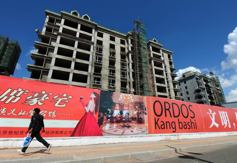 Empty apartment buildings stand in the city of Ordos, Inner Mongolia on Sept. 12, 2011. (MARK RALSTON/AFP/Getty Images)
