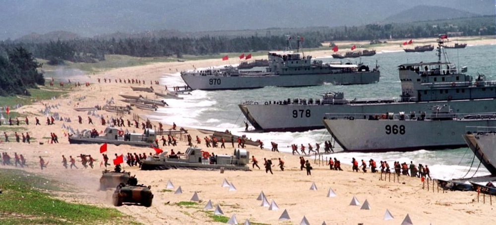 The People's Liberation Army storms ashore from landing crafts in an exercise on the mainland coast close to Taiwan, on Sept. 10, 1999. (STR/AFP/Getty Images)