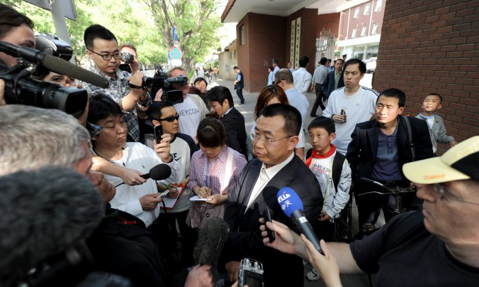 Foreign journalists interview Chinese rights lawyer Jiang Tianyong in Beijing on May 2, 2012. (Mark Ralston/AFP/Getty Images)