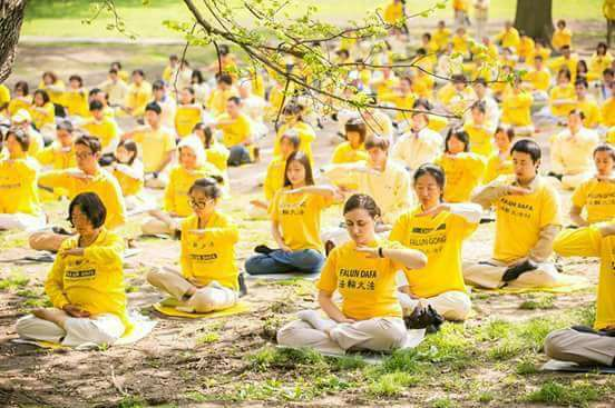 A group of Falun Gong practitioners are meditating.