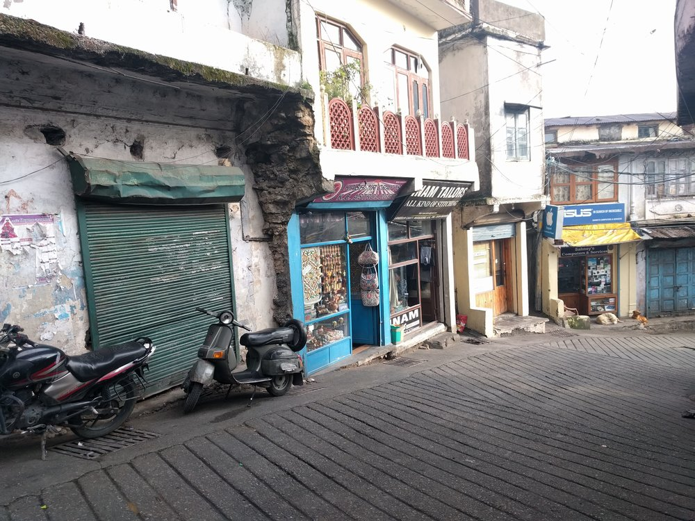 """A few Mussoorie shopfronts, including """"our"""" tailor and electronics store"""