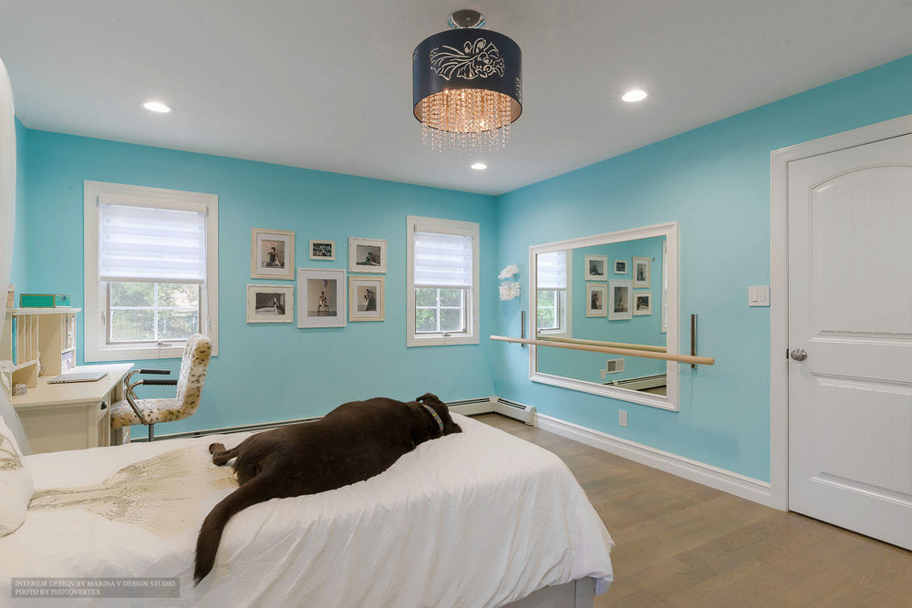 Bedroom design with dog in bed and stylish pendants chandelier on ceiling