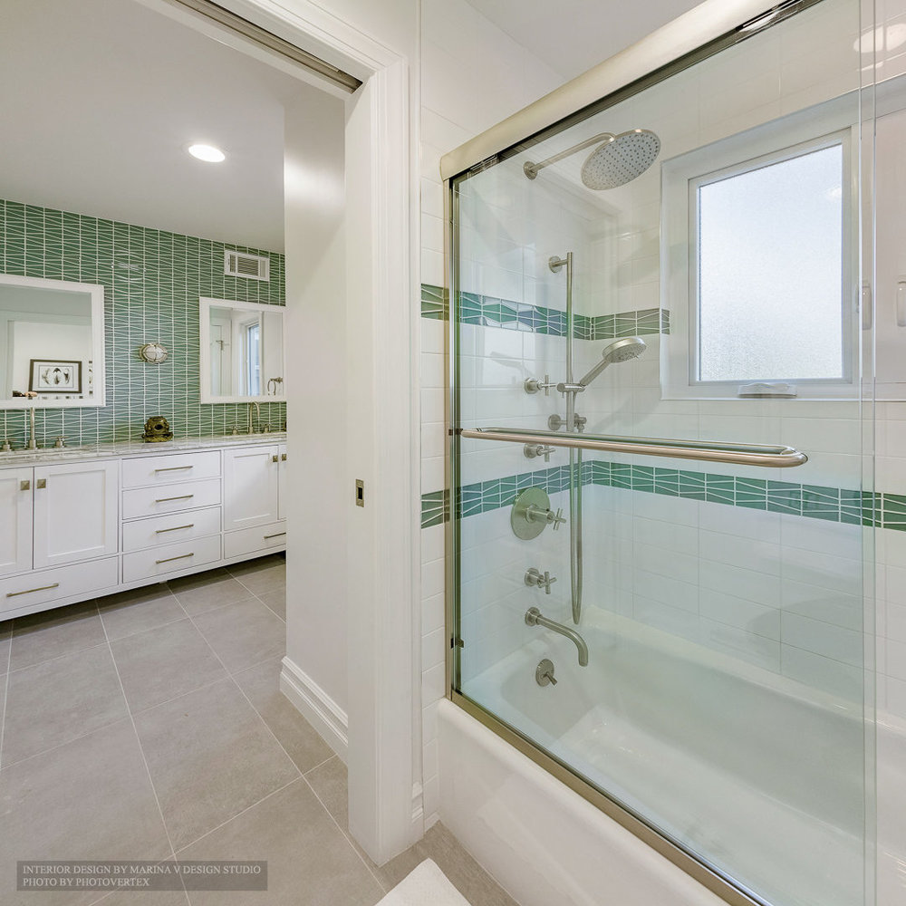 Shower room with bathtub viewing sink counters