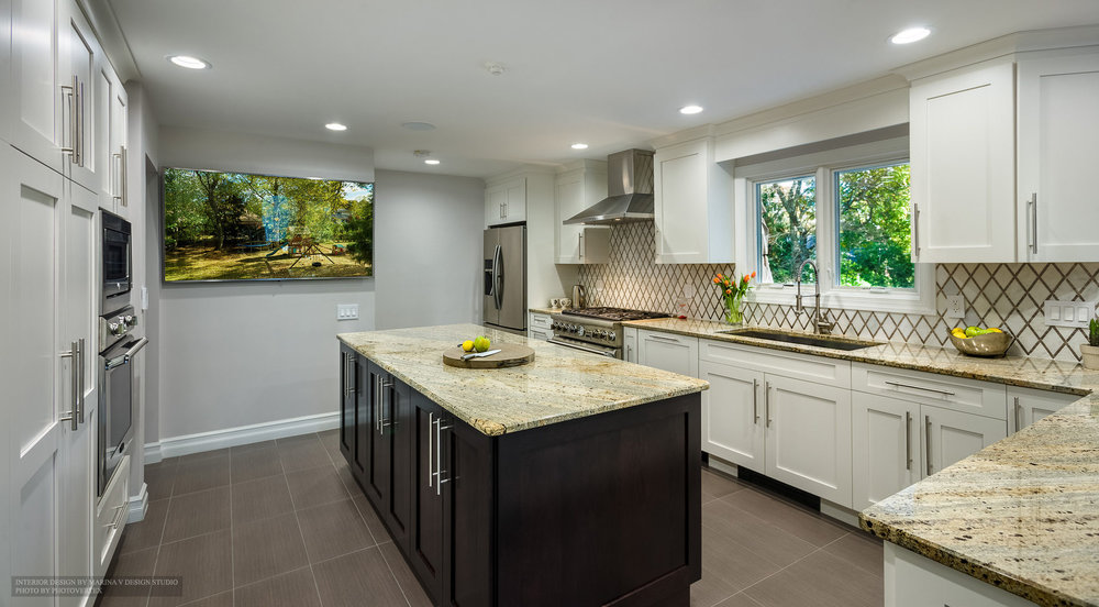 Kitchen interior with granite top island counter and cabinets