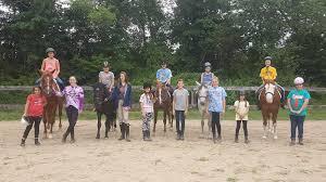 Volunteers with horses.jpg