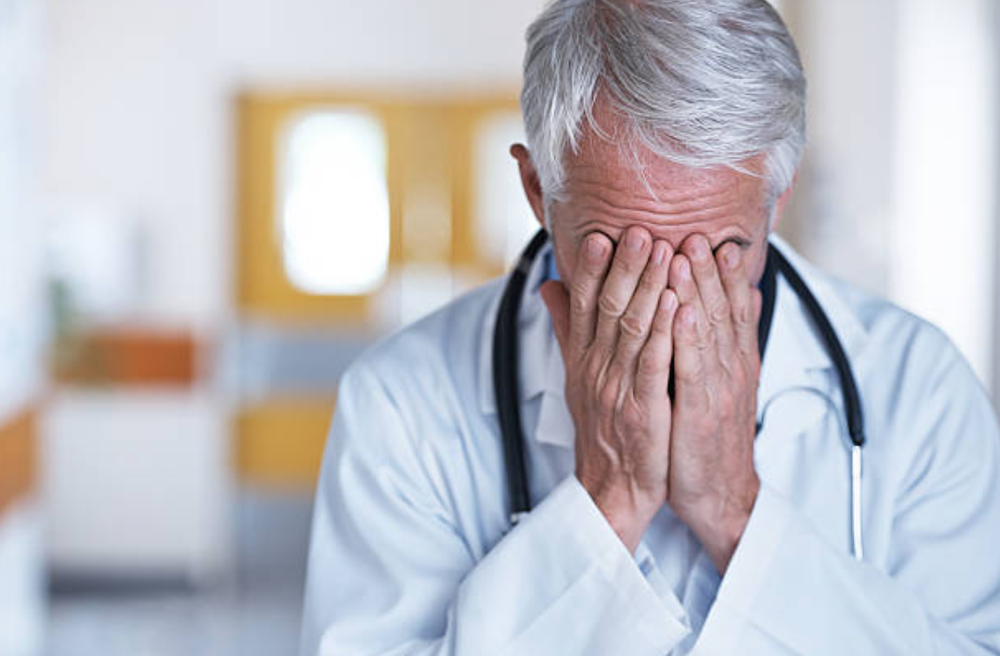 Overwhelmed_Doctor_Pictures__Images_and_Stock_Photos_-_iStock.png