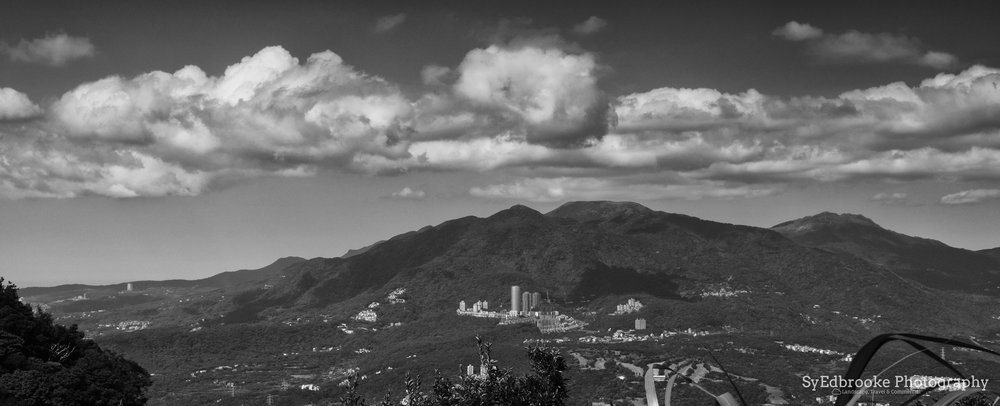 Mt. Datun and YangMingShan Peaks the opposite side of the river. f11, ISO 200, 1/100, 50mm
