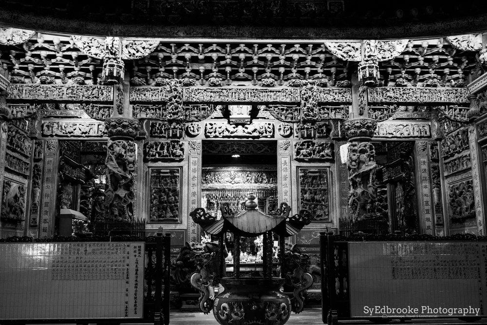 a roadside shrine. f1.8, ISO 1600, 1/50, 17mm