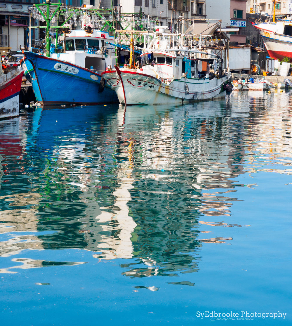 Harbor reflections. f14, ISO 200, 1/50, 43mm