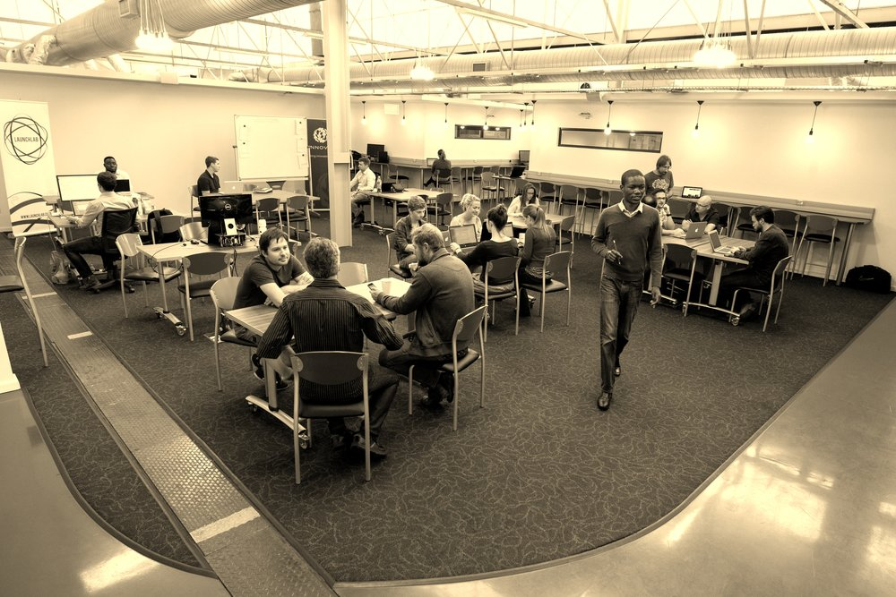 LaunchLab hotdesk area with members working with each other