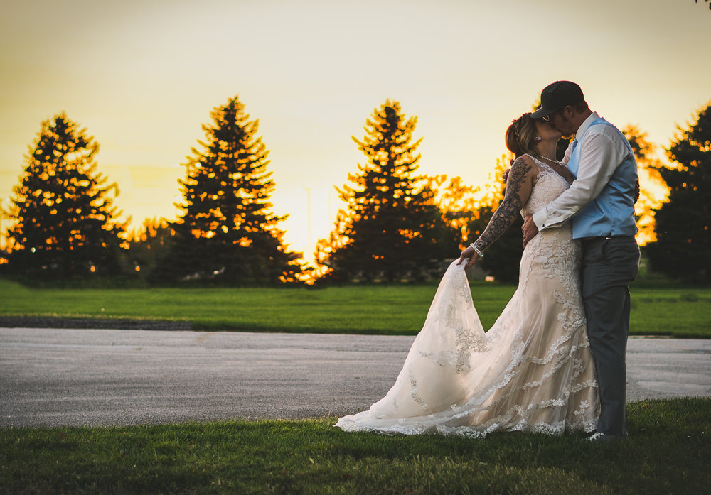 Kissing the Night Away, Newlyweds Kissing the evening away at sunset in Altoona, IA