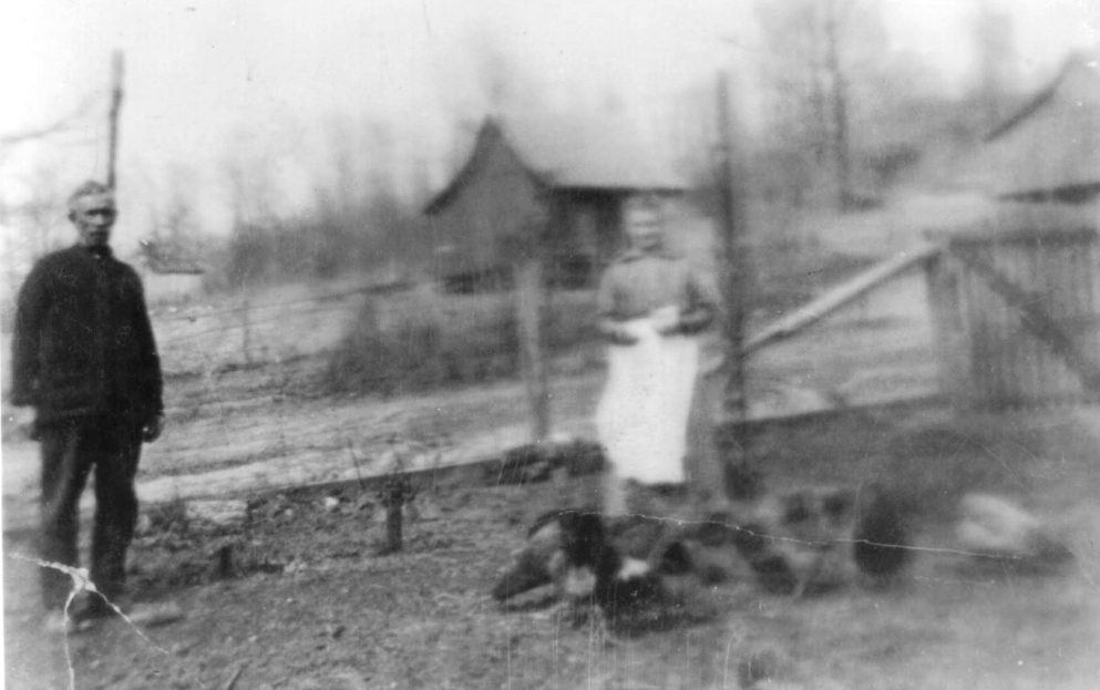 Charles Sr., Elizabeth    Feeding the Chickens