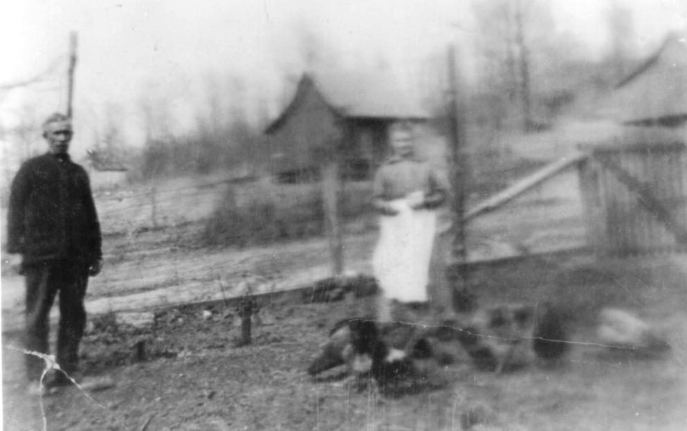 Charles Sr., Elizabeth    Feeding the Chickens