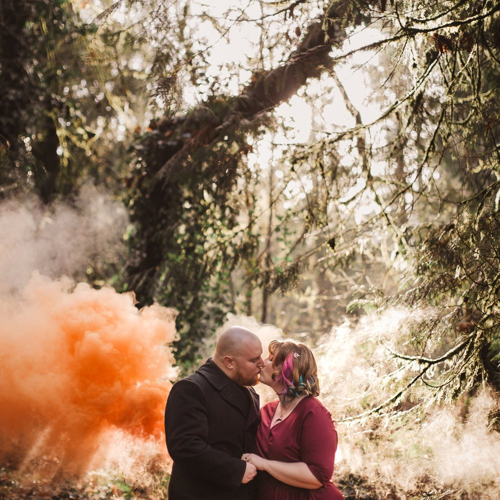 orange smoke bomb grenade engagement photo forest sharp shutter studios