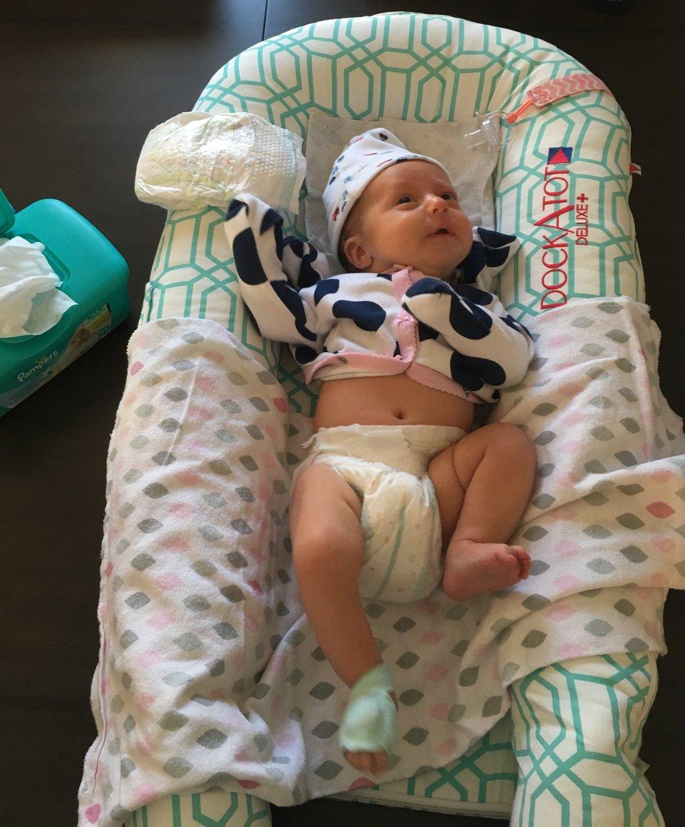 Baby Bird having her diaper changed in the Dock-A-Tot.JPG