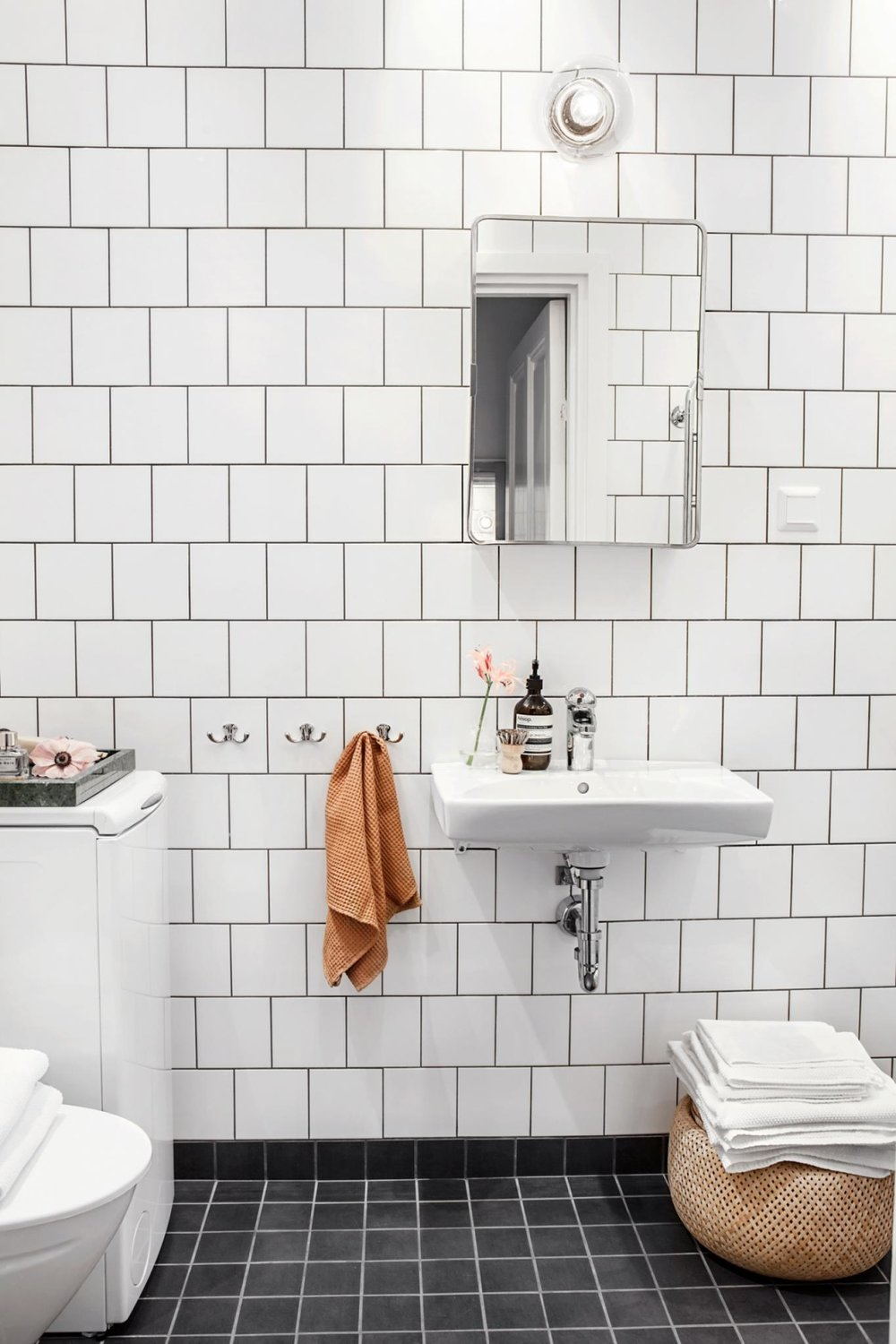 Bathroom with square white wall tile