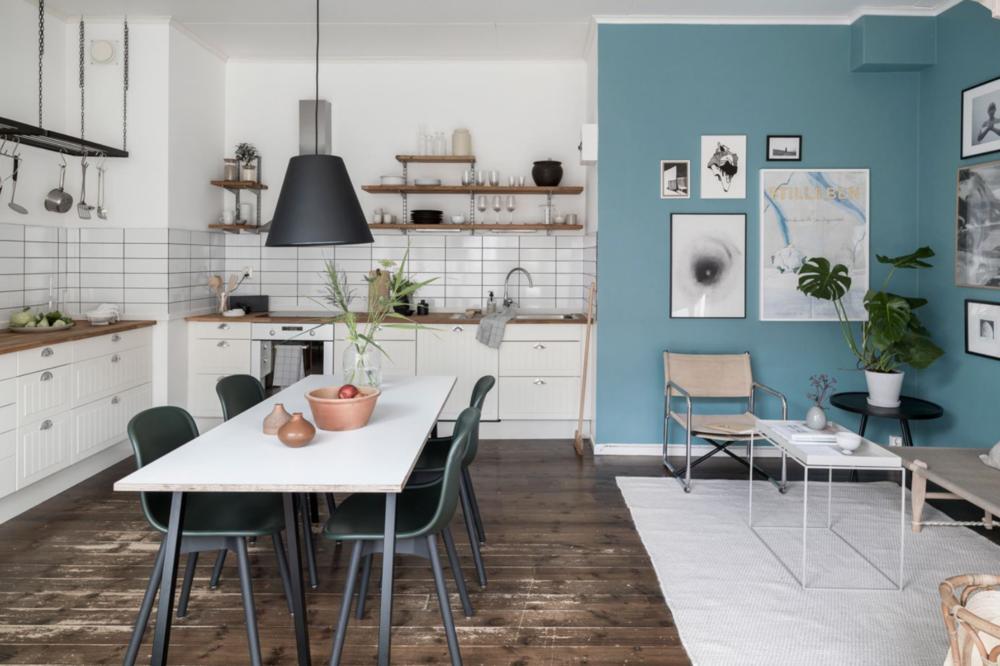 White kitchen blue living room