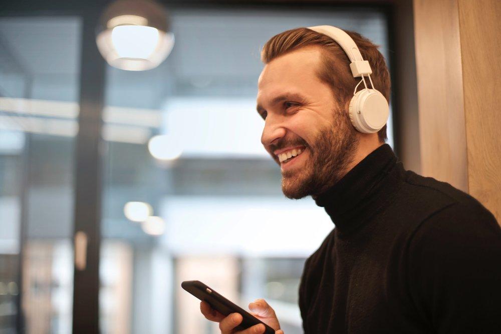 white-man-listening-phone.jpg