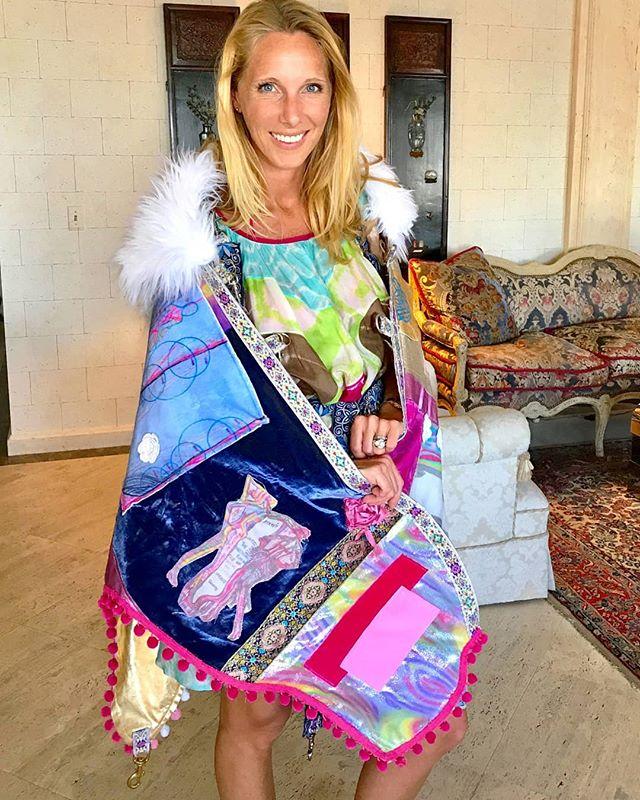 The beautiful @namastrid wearing our original Victoria Phoenix Unicorn Castle Art Cape!