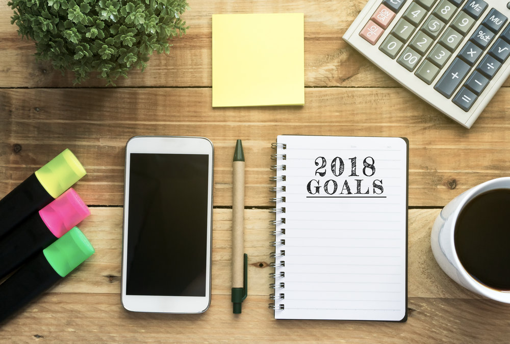 New-Year-2018-Goals-list-written-on-a-notepad-866936588_5000x3377.jpeg