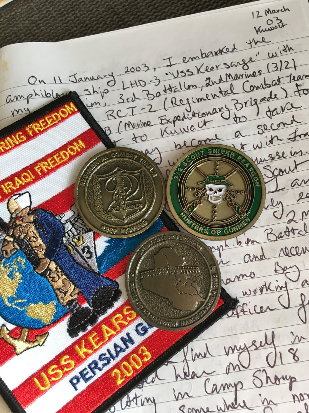 The front page entry of my solitary journal entry, along with some coins a patch made by the ship's company of USS Kearsarge (LHD-3) which brought us to and home from Iraq in 2003