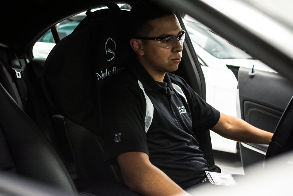 Campaign photo by Erin Marie Miller of student mechanic in training for Mercedes-Benz DRIVE, 2017.