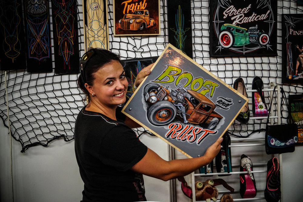 Amfiria showcasing some of her artwork