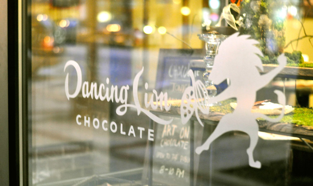 Window treatment for Dancing Lion Chocolate in their retail storefront and cafe, New Hampshire.
