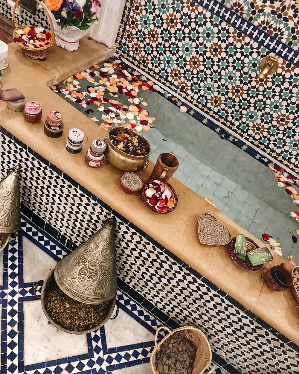 the HAMMAM BATH -  Before embarking on the trip we were told that we could not leave Morocco without experiencing a traditional Hammam bath -- we weren't told too much more.The lovely couple we were staying with in Fez suggested a bath house in the Medina. She said it was