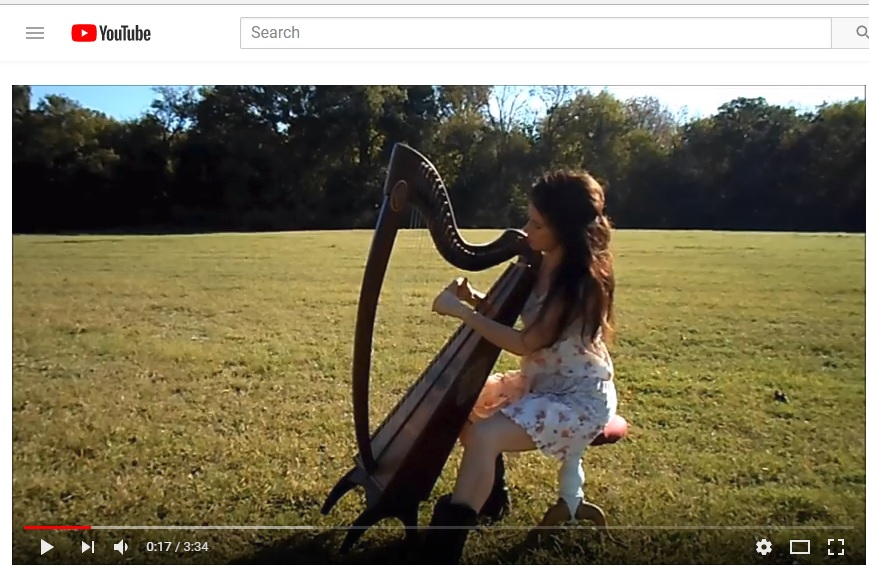 Playing harp in my meadow