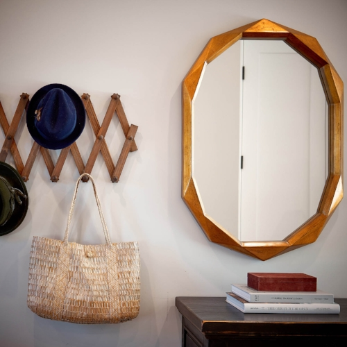 We have worked in some beautiful books to compliment this fab mirror as well as an accordion hook that doubles as a decor element and a place to hang necessities.