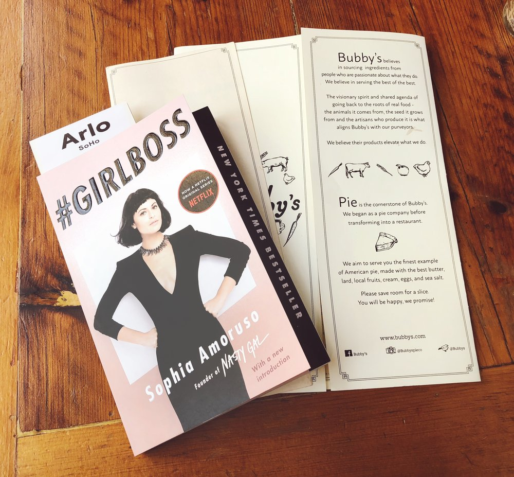 Reading a little Girlboss while grabbing some food at Bubby's in NYC.