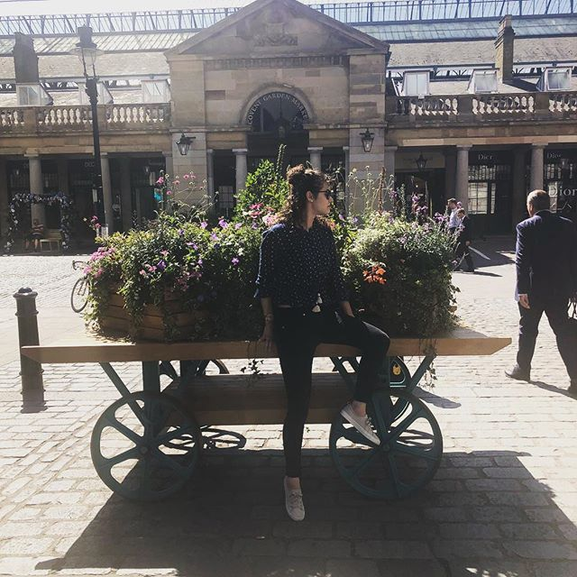 Don't mind me. Just sitting on someone's flower cart. #flowers #travel #travelfashion #whatiwore #england #london #london2018 #unitedkingdom #curlyhair
