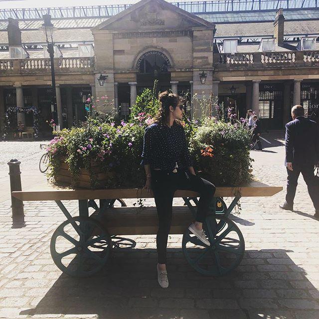 Don't mind me. Just sitting on someone's flower cart. #flowers #travel #travelfashion #whatiwore #england #london #london2018 #unitedkingdom #curlyhair