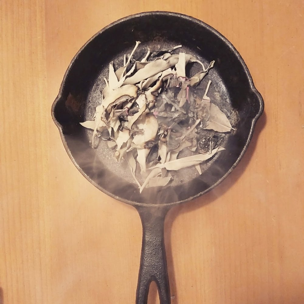 burning sage in cast iron pan