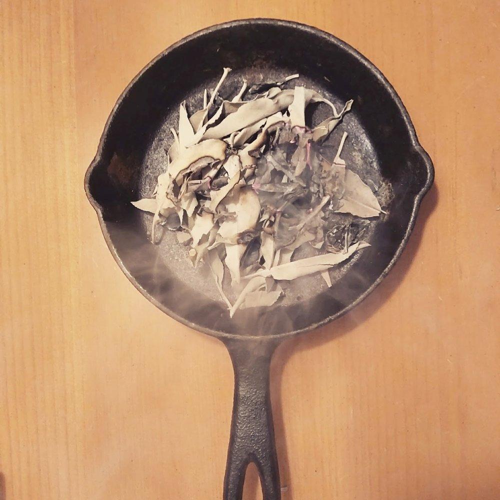 burning sage in cast iron pan