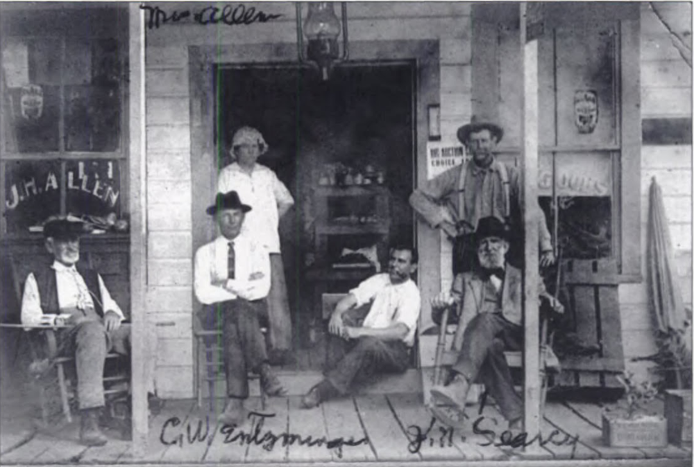 Prominent Longwood pioneers sitting on the front porch of the J. H. Allen store.