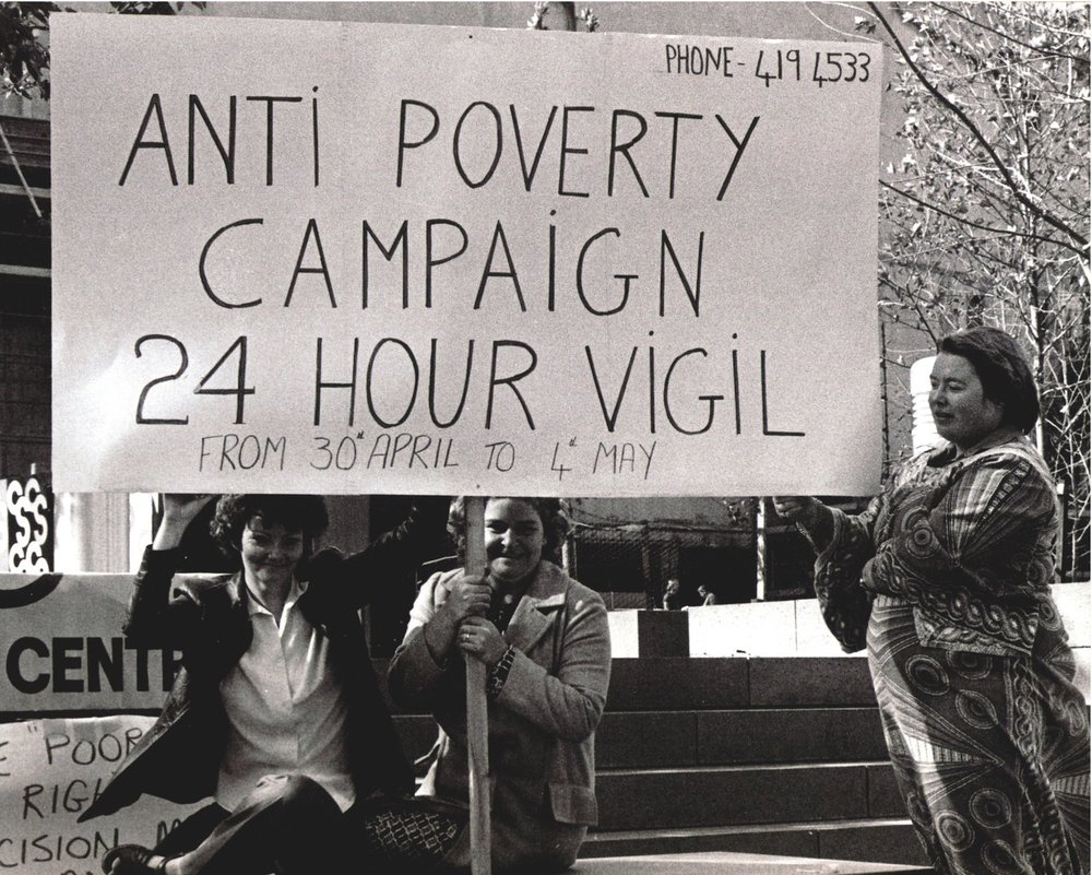 3-people-holding-banner_Anti-Poverty-Campaign-24-hour-vigil-from-30th-April-to-4th-May_1979.jpg